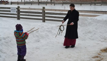 staff playing victorian games with kids