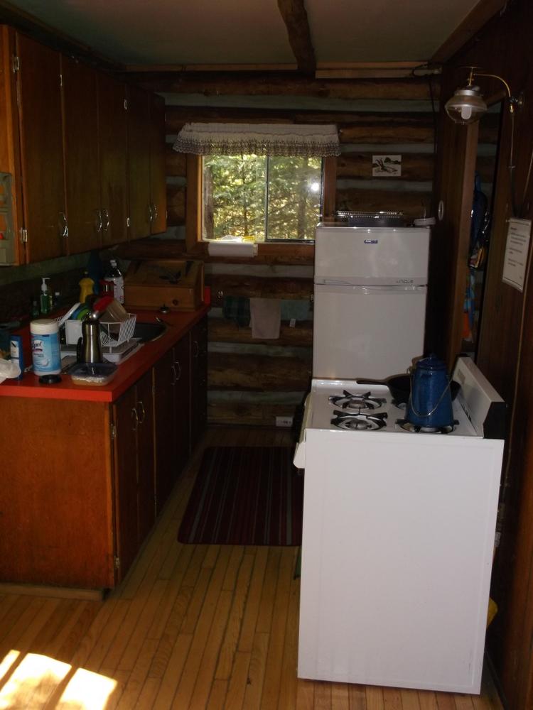 rain lake ranger cabin kitchen
