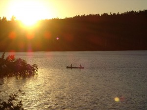 Canoeing in Quetico Provincial Park during sunset