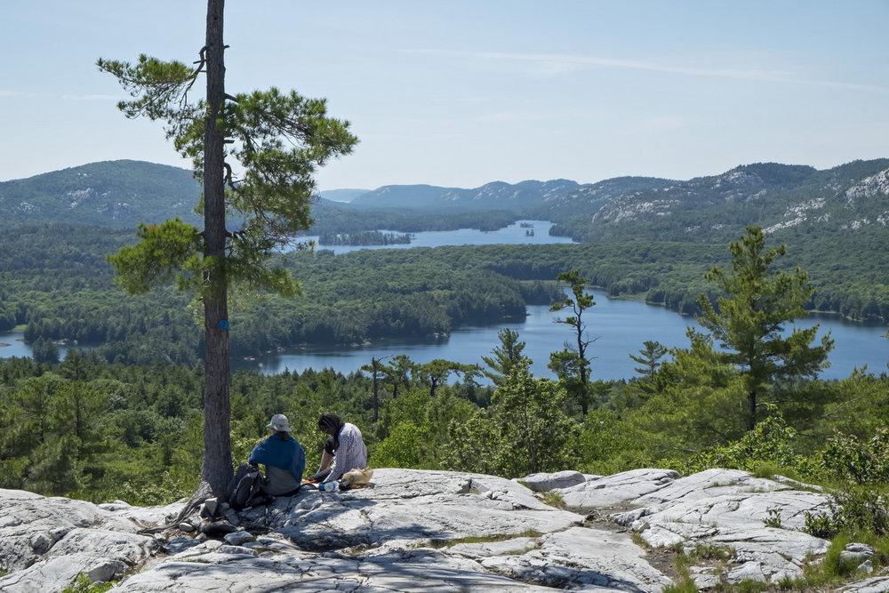 Hikers resting atop Crack Trail, Killarney Provincial Park