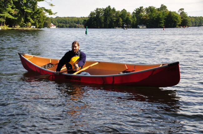 Jay, the owner of Paddleshack store in Bala (Muskoka), with Legend Prospector 16.7 Canoe